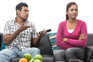 couple arguing on couch