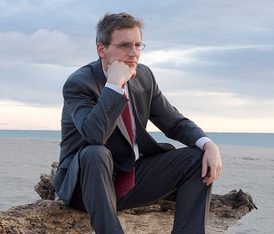 upset man sitting on beach