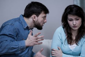 divorced couple - man berating ex-wife