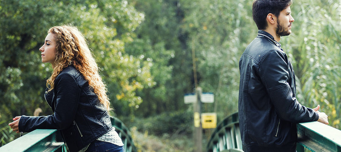 unhappy couple on bridge