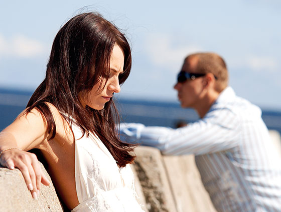 upset couple at pier